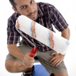 Close up view of man holding roller — Stock Photo #1652782