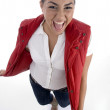 Pretty girl posing in her red jacket — Stock fotografie