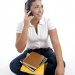 Young student busy on phone call — Stock Photo