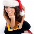 Student with christmas hat with books — Stock Photo