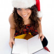 Smiling student with christmas hat — Stock Photo #1652887