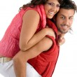 Stock Photo: Woman riding piggy back on man