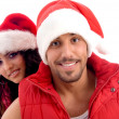 Young friends dressed in christmas hat — Stock Photo