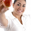 Smiling young female showing apple — Stock Photo