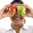 Woman posing with apples as eyes — Stock Photo #1653076