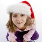 Sweet girl with christmas hat — Stock Photo