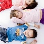 Cute children lying on floor — Stock Photo