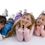 Cute children on floor looking upwards — Stock Photo