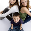 Young kid sitting with his teen sisters — Stock Photo #1653479