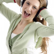 Woman taking the pleasure of music — Stock Photo