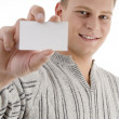 Smiling man showing businesscard — Stock Photo