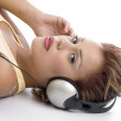Woman with headphone looking at you — Stock Photo #1653852