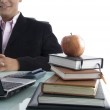 Businessman with apple and books — Stock Photo
