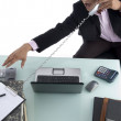 Angry businessman busy on the phone — Stock Photo #1654083