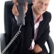 Stock Photo: Happy businessmshowing receiver