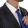 Executive holding his tie, close up — Stock Photo #1654932