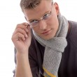 Handsome young male holding eye-wear — Stock Photo #1655005