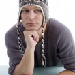 Portrait of young man wearing winter cap — Stock Photo