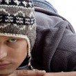 Portrait of young man wearing winter cap - Stock Photo