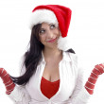 Smiling woman wearing christmas hat — Stock Photo