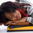 Tired school girl sleeping on her books — Stockfoto