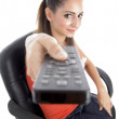 Young girl posing with remote - Stock Photo