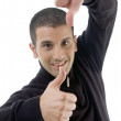 Young guy with thumbs up and down — Stock Photo #1656211