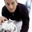 Male model lying with disco ball — Stock Photo #1656236