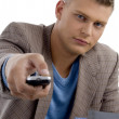 Young man with remote control — Stock Photo