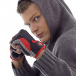 Sportive guy showing exercise gloves — Stock Photo #1656554