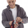 Sportive  guy with exercise gloves — Stockfoto