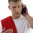 Sportive man busy on mobile call — Stock Photo #1656566