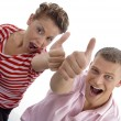 Corner view of couple with thumbs up — Stock Photo