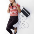 Young woman with laptop and headphones — Stock Photo