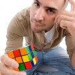 Confused man holding puzzle cube — Stock Photo