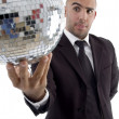 Young executive looking at disco ball — Stock Photo