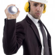 Stock Photo: Architect with blueprint and earplugs