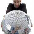 Handsome young man holding disco ball — Stock Photo #1657139