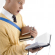 Royalty-Free Stock Photo: Smart young student managing his books
