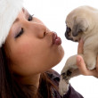 Young woman playing with cute puppy — Stock Photo