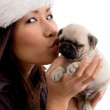 Gorgeous young female kissing puppy — Stock Photo