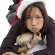 Woman with christmas hat and puppy — Stock Photo