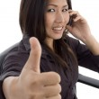 Woman showing thumbs up while talking — Stock Photo #1658539