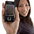Young female showing mobile to camera — Stock Photo #1658541
