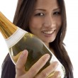 Beautiful woman handling champaign — Stock Photo