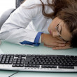 Stock Photo: Sleeping young female doctor in clinic