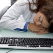 Sleeping young female doctor in clinic — Stock Photo
