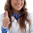 Smiling doctor showing thumbs up - Stock Photo