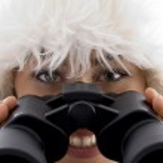 Close up view of woman holding binocular — Stock Photo