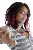African girl with scissors — Stock Photo